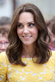 Kate Middleton looked oh-so-pretty with her mid-length waves during her tour of Heidelberg, Germany.