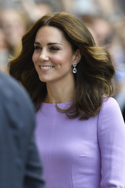 Kate Middleton complemented her lavender dress with a pair of amethyst drop earrings by Kiki McDonough.