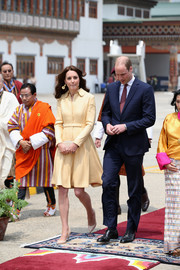 Kate Middleton kicked off her two-day visiti to Bhutan wearing a business-chic coat dress by Emilia Wickstead.