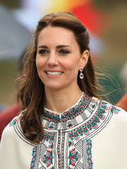 Kate Middleton paired her 'do with lavender amethyst drop earrings by Kiki McDonough.