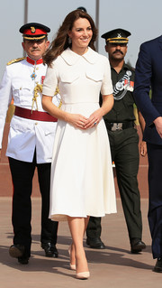 Kate Middleton looked prim and proper in a collared white midi dress by Emilia Wickstead while touring India.
