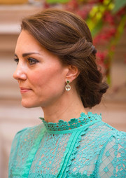 Kate Middleton polished off her look with a pair of gemstone drop earrings.