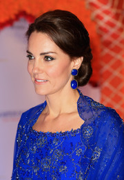 Kate Middleton styled her hair into an elegant chignon for a charity gala in India.