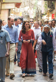 Kate Middleton donned a long-sleeve printed maxi dress by Glamorous for day 3 of her India tour.