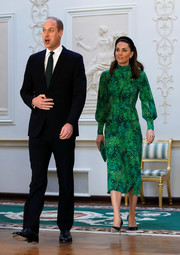 Kate Middleton met with the President of Ireland wearing a stylish green floral dress with a peplum waist.