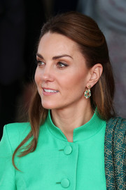 Kate Middleton looked demure and elegant wearing this half-up hairstyle while attending a meeting with Pakistan's Prime Minister, Imran Khan.