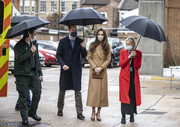 Kate Middleton stayed warm in a camel-colored wool coat by Massimo Dutti for a visit to the Newham ambulance station in East London.