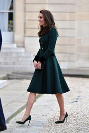 Kate Middleton looked impeccable in a green Catherine Walker coat dress with gold buttons and velvet cuffs while visiting Paris, France.