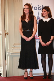Kate Middleton looked simply elegant in a sleeveless black tweed dress by Alexander McQueen while attending a reception at the British Embassy in Paris.