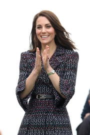 Kate Middleton paired a black leather belt with a tweed coat, both by Chanel, for day 2 of her Paris trip.