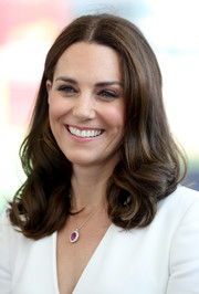 Kate Middleton polished off her look with a classic ruby and diamond pendant necklace.