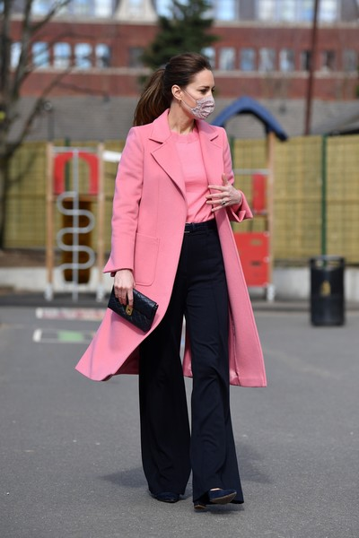 Kate Middleton looked cheery in a pink wool coat by MAX&Co. while visiting School 21 in Stratford.