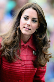 Kate Middleton stuck to her customary long feathery hairstyle when she went on a tour of Scotland.