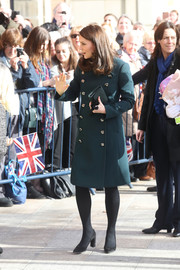 Kate Middleton kept cozy in style with a green Dolce & Gabbana coat with gold buttons for her visit to Sunderland.