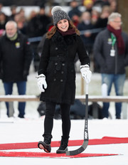 Kate Middleton showed off her chic winter style with this black Burberry trenchcoat while touring Sweden.