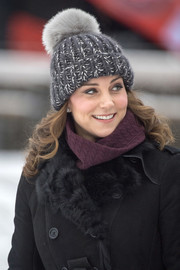 Kate Middleton topped off her look with a cute gray pompom beanie by Eugenia Kim.