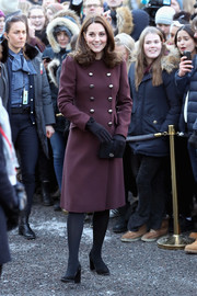 Kate Middleton visited Hartvig Nissen School in Norway wearing a double-breasted mauve coat by Dolce & Gabbana.