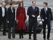 Kate Middleton took to her royal duties in Denmark in a red coat paired with black suede knee-high boots.