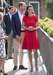 Kate Middleton kept it simple and demure in a short-sleeve red dress by L.K.Bennett when she visited the YoungMinds Mental Health charity helpline.