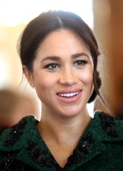 Meghan Markle styled her hair into a side chignon for a Commonwealth Day youth event.