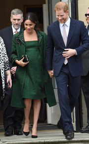 Meghan Markle kept it classy in an embellished green coat by Erdem at a Commonwealth Day youth event.
