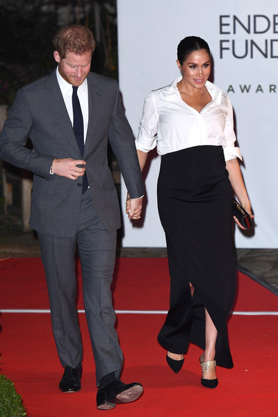 Meghan Markle went for glam styling with a pair of black and gold pumps by Aquazzura.
