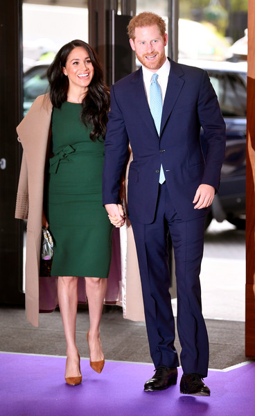 Meghan Markle donned a bow-adorned green sheath dress by P.A.R.O.S.H. for the WellChild Awards.