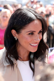 Meghan Markle accessorized with a beautiful pair of diamond butterfly earrings previously owned by Princess Diana.