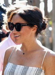Meghan Markle styled her hair into a casual bun for her tour of Fraser Island, Australia.