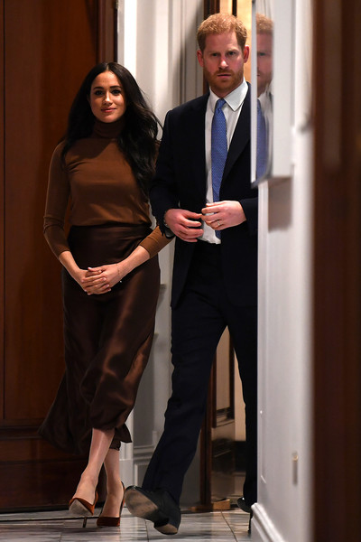Meghan Markle visited Canada House in London wearing a brown turtleneck by Massimo Dutti.