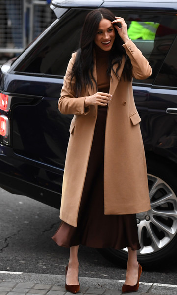 Meghan Markle arrived at Canada House in London wearing a camel-colored wool coat by Reiss.