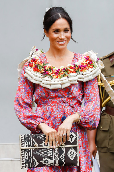 Meghan Markle arrived at the University of the South Pacific carrying a clutch printed with traditional Fijian art.