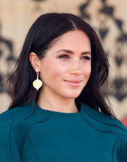Meghan Markle finished off her look with a pair of gold peepal leaf earrings by Pippa Small.
