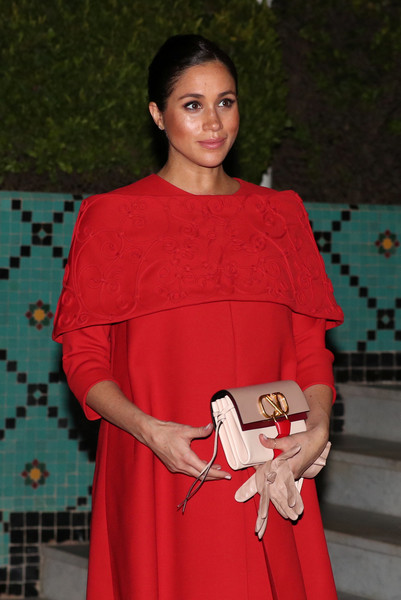 Meghan Markle paired a nude leather clutch with a red maternity dress, both by Valentino, for a meeting with the Crown Prince of Morocco.