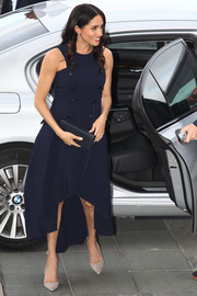 Meghan Markle looked simply stylish in a navy high-low dress by Antonio Berardi while attending a reception at the Auckland War Memorial Museum.