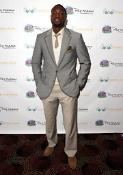 Dwyane paired her cream trousers with a tuxedo style grey striped blazer and tan suede loaders. Timeless!