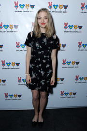 Amanda Seyfried kept it breezy in a floral mini dress with shoulder cutouts at the Dylan's Candy Bar launch event.