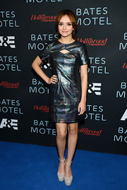 Olivia's shimmery metallic dress featured a cool capped-sleeve element and a diamond cutout at the bust.