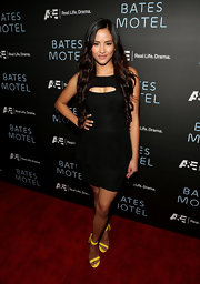 Emmalyn Estrada opted for a classic black dress with funky modern details like a cutout at the chest and peplum bodice.