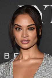 Shanina Shaik pulled her locks back into an elegant ponytail for the E!, ELLE, and IMG NYFW kickoff celebration.