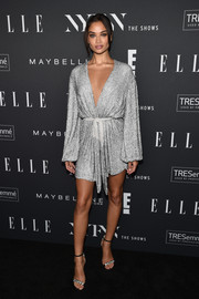 Shanina Shaik looked alluring in a sequined wrap dress at the E!, ELLE, and IMG NYFW kickoff celebration.