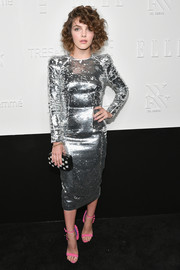Camren Bicondova tied her look together with a checkerboard beaded clutch by Henri Bendel.