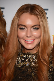Lindsay Lohan added a touch of soft coral lipstick to her bronzy look.