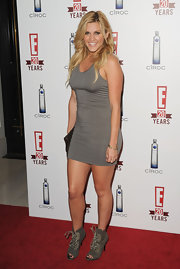 Ashley showed off her fit figure in a short gray dress at E Televisions's 20th Birthday party.