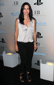 Courteney Cox looked sleek and casual in a loose silver blouse and darn denim.