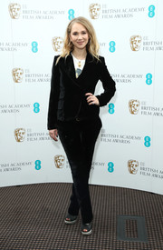 Juno Temple teamed a black velvet pantsuit with a T-shirt for the EE BAFTA Rising Star nominations announcement.