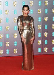 Zoe Kravitz looked magnificent in a long-sleeve gold chainmail gown by Saint Laurent at the 2020 EE British Academy Film Awards.