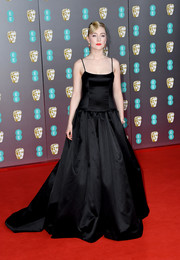 Saoirse Ronan kept it minimal in a black spaghetti-strap ballgown by Gucci at the 2020 EE British Academy Film Awards.