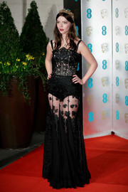 Anya Taylor-Joy brought a dose of sultry glamour to the EE British Academy Film Awards with this sheer black lace gown by Dolce & Gabbana.
