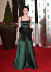 Rachel Brosnahan looked like a princess in this delicately beaded green gown with an oversized bow accent at the EE British Academy Film Awards.